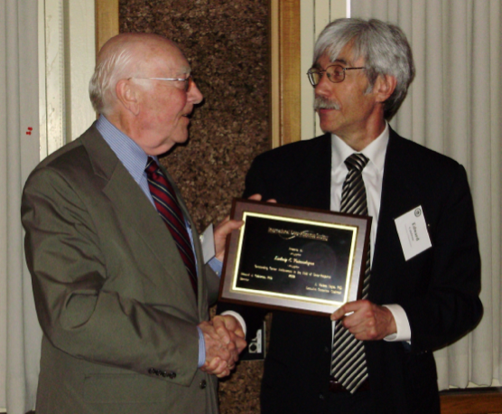 Dr. Edward J. Calabrese presents to Ludwig Emil Feinendegen, M.D. The International Dose-Response Society Outstanding Career Achievement Award